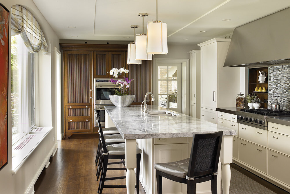 This kitchen by JamesThomas features a trio of Soleil Petite Pendants.