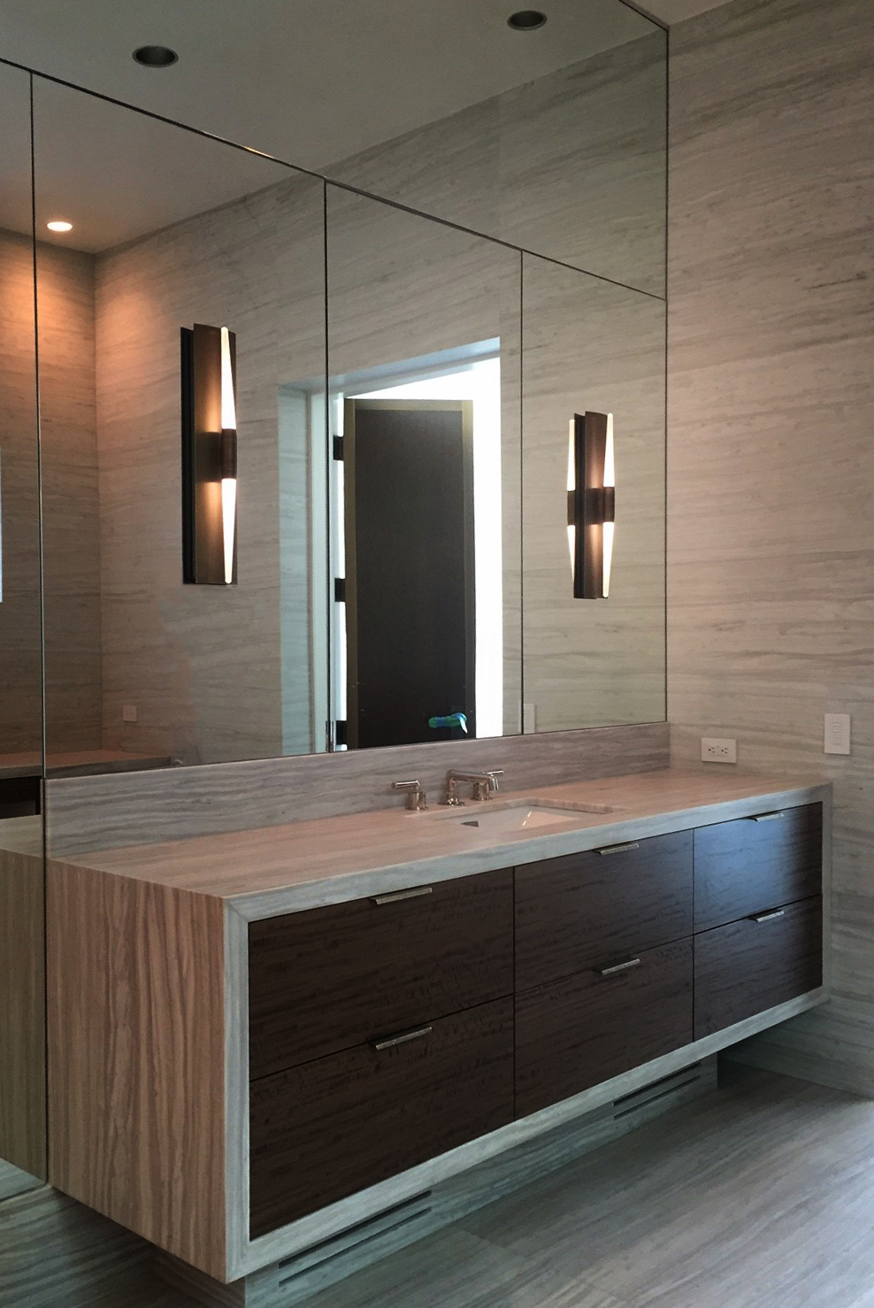 This bathroom by  Laura Lee Clark Interior Design  features the Icicle Wand Sconce in Blackened Brass with etched glass.
