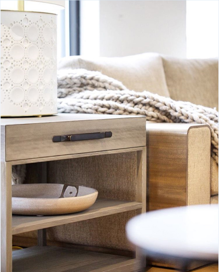 A chunky throw blanket ensures that guests will stay nice and warm while reading beside the Alhambra Table Lamp.