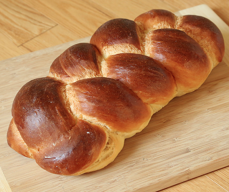 Challah Classic European braided egg bread. This light, airy bread keeps well due to the high amount of eggs white, egg yolks, and oil in it. It is great for sandwiches and even better for french toast.