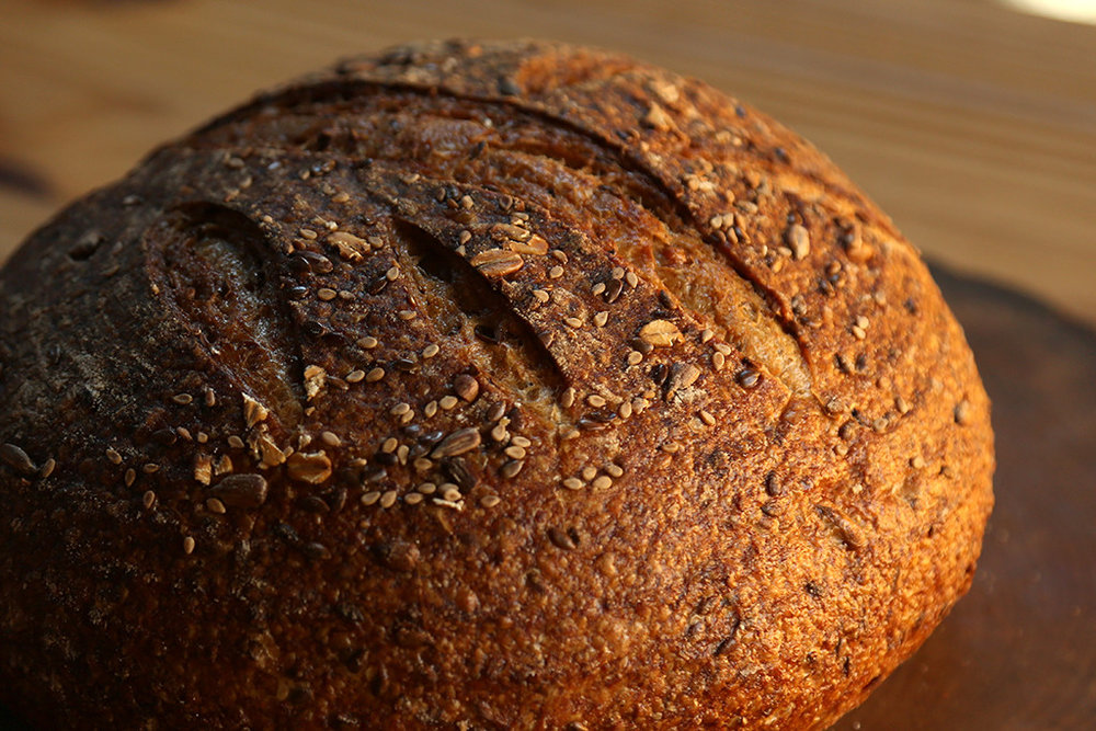 Grain-Up Similar to our Three-seed Sourdough, it differs in that it has whole wheat instead of rye flour (1/3 whole wheat). It also has oats, sunflower, flax, and rye chops. The sunflower seeds are toasted and the flax is soaked. This is our truest multi-grain bread.