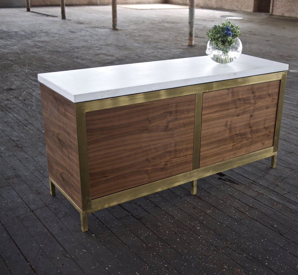 Fia Credenza. Walnut, Brass, Concrete (shown) also available in Walnut, Steel, Concrete