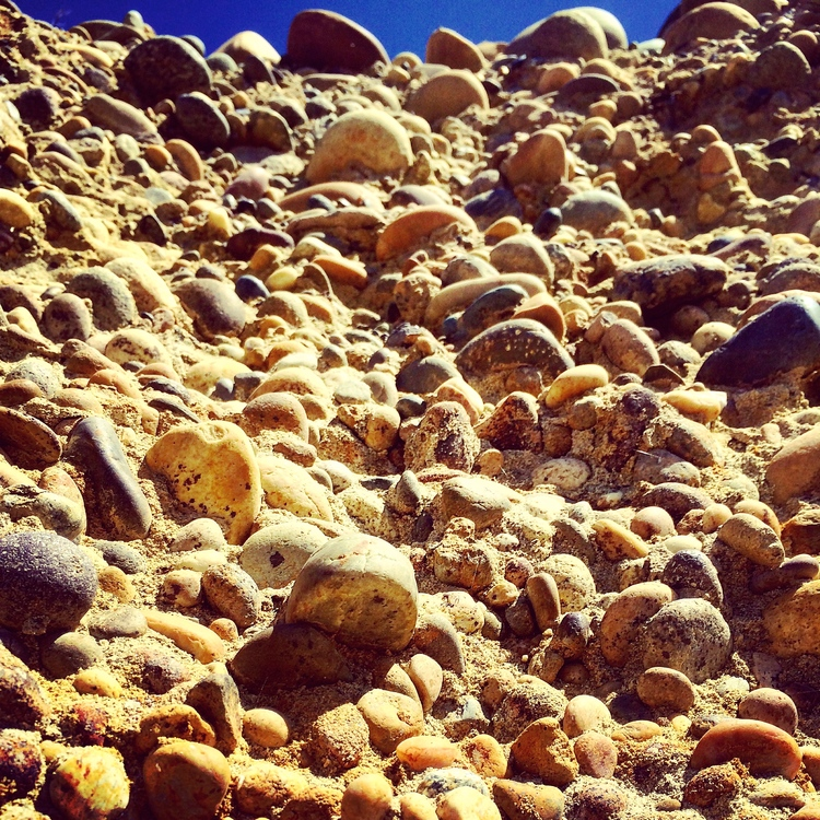 Large pile of rocks gleaming in the sunlight