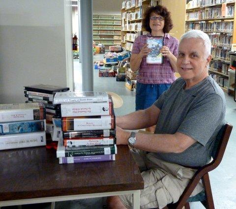 Jill and Allen prepare audio books for sale.