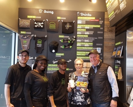 Friends Board Member and Assistant Library Director meet with Shake Shack staff during Dining for Dollars.