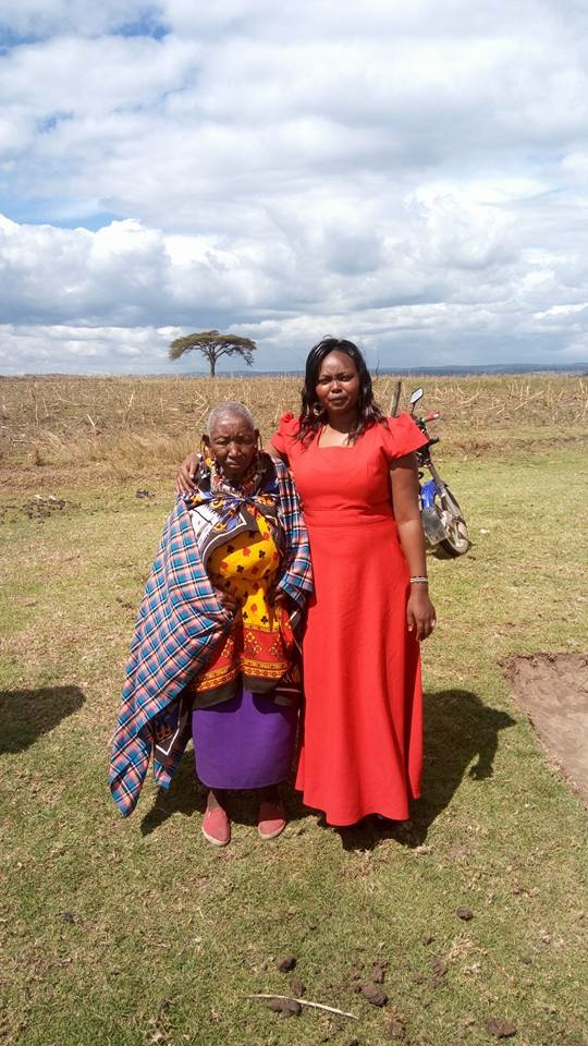 Ann, who has completed her diploma in Peace and Conflict Resolution (pictured with her grandmother)