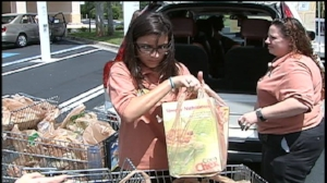 Help someone with their groceries - Kids helping people carry out their groceries