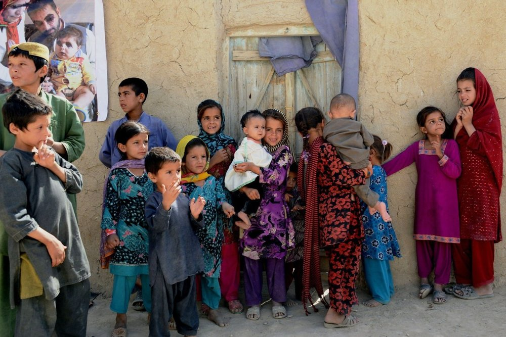 Afghan children wait to receive polio vaccines Tuesday during an antipolio campaign in the southern province of Kandahar. Afghanistan is one of only two countries in which the disease remains.  PHOTO: SANAULLAH SAIEM/ZUMA PRESS
