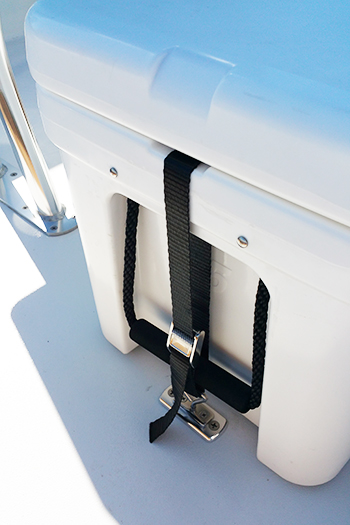 Threaded Deck Plates, T-Bolts, and Straps securing an RTIC 45 on the bow of an East Cape Vantage. Plates are mounted on top of factory-installed plates.