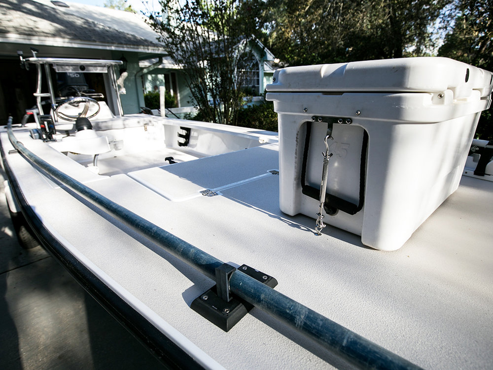 Threaded Deck Bolts, Eye-Bolts, Turnbuckles, and Turnbuckle Adapters securing and RTIC 45 on the bow of a Pathfinder poling skiff