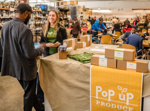 Pop Up Produce sets up a pop up shop inside 7th Street Public Market. Photo Credit: Walker Visual