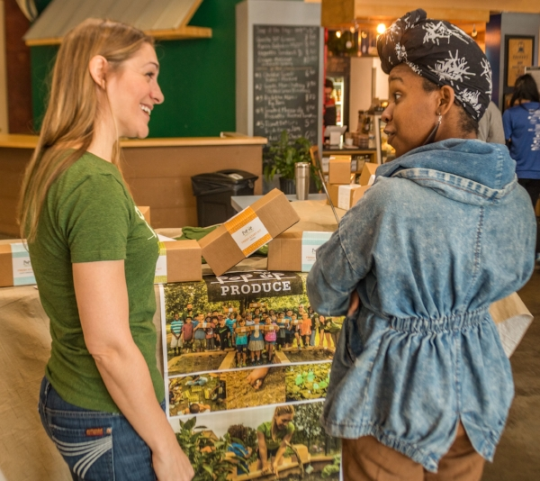 Founder, Amanda Zullo, chatting with a Fresh Start Kit owner about our work in food deserts. Photo Credit: Walker Visual
