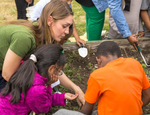 Pop Up Produce Founder, Amanda Zullo, teaching students about seed spacing.
