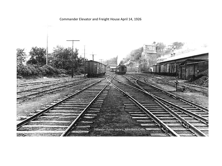 This is a view south toward the Commander Elevator, showing the railroad activity in this area of Stillwater.  It also shows the Freight House on the right when it was both a freight and passenger depot.