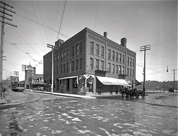 "Lumbermen's Exchange Building, 1914. In the background is the Union Station and a nearby trolley. Photo Courtesy of Stillwater Public Library, John Runk Collection. Click or Tap this photo to reveal a ""Time Tunnel"" of this same location from 1914 to 2016."