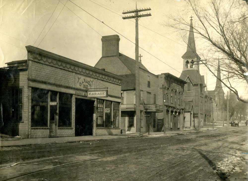 "This is a view north from Third Street and Chestnut.  You are able to see three church steeples.  The nearest is the Presbyterian Church, followed by Trinity Lutheran Church, then Ascension Episcopal Church in the distance. Between the first two steeples, lies the firehouse. Streetcar tracks are in the foreground on Third Street. The year is 1917. Click or tap the photo to see a ""Time Tunnel"" photo between 1917 and 2016."