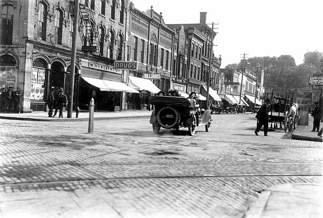 "Main Street and Chestnut, View South ca. 1920's.  Photo Credit, Stillwater Library, John Runk Collection. Click or Tap on photo to view ""Time Tunnel"" photo of this same scene from the 1920's to 2016."