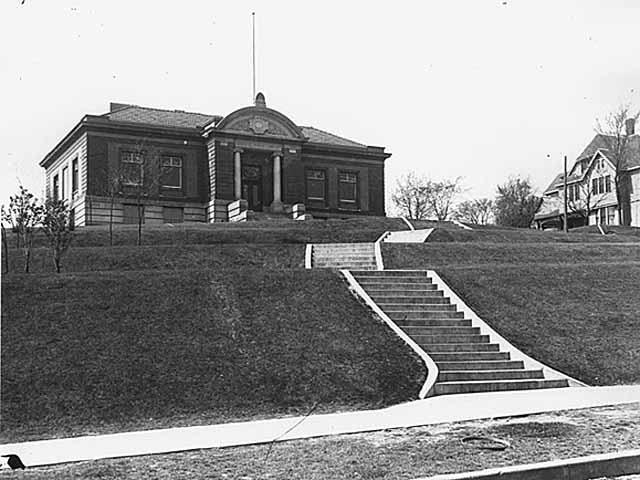 "This is a view of the Stillwater Carnegie Library.  The view is WNW from 3rd Street.  Photo Credit; Stillwater Public Library, John Runk Collection. Click or Tap the photo to view a ""Time Tunnel"" from the 1920's to 2016.         Carnegie Library, Narrative by R. Molenda Andrew Carnegie was a businessman and philanthropist.  Many libraries were built across the USA under grants offered by Carnegie. A total of 2,509 Carnegie libraries were built worldwide between 1883 and 1929. In the USA, a total of 1,689 were built under grants that required agreement to terms set by Mr. Carnegie. Many of the libraries were unique, the library in Stillwater being no exception. The community was responsible for choosing the style, in this case, Beaux-Arts for the Stillwater library. The grants from the Carnegie Foundation were large. In Stillwater, Carnegie contributed $27,500. The grant for the Stillwater library was more than twice the amount of a typical Carnegie grant for this time period. More About The Carnegie Library"