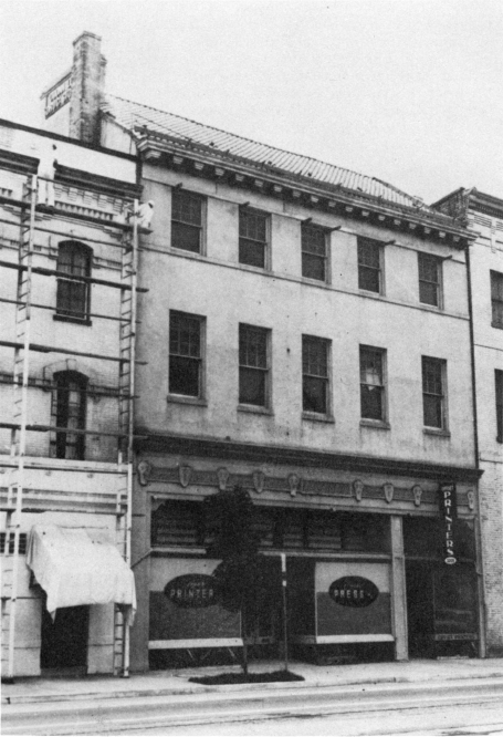 The City Tavern building as it stood before restoration, circa 1959,   via