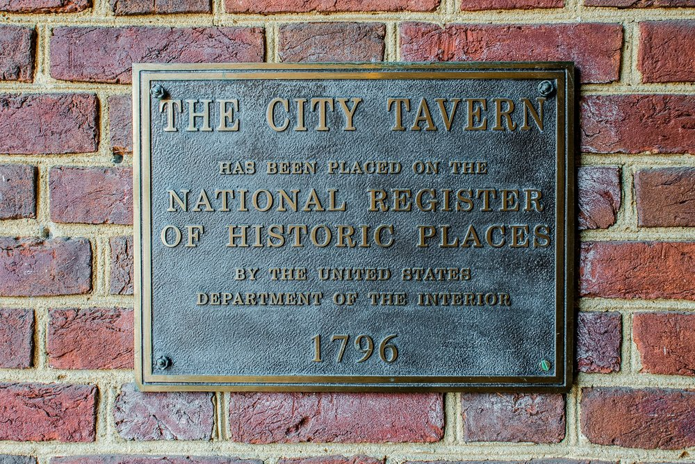 The historical marker plaque,   via