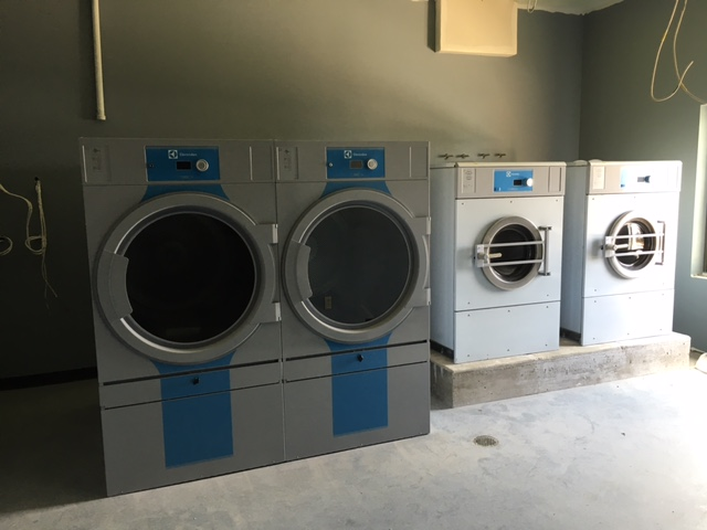 Two T5675 83 lb dryers and two W5280X 65 lb washers.  The washers are 300 g-force to help extract more water before drying.