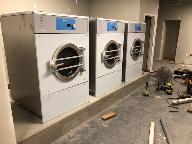 Some W5280Xs being installed.   Note the fancy tile on the front of the pad.  Not a bit of it was chipped on install.  Last, these are stainless machines.  The front, protective stickers have yet to be peeled.  We'll wait until construction is over.