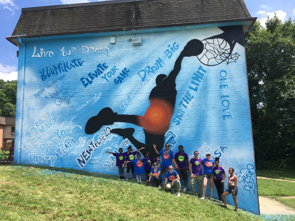 """Participants and artist/mentors with finished """"Slam Dunk"""" mural, June 24, 2018."""