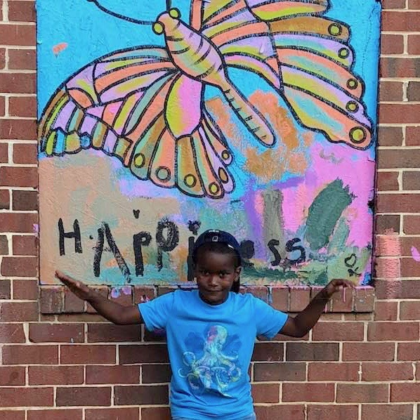 Young artists from Newtowne 20 and Woodside Gardens gathered along with FHN, BWSA, and artist/mentors Lindsay Bolin, Anthony LaVorgna, Dani Campbell, Troy Reid, Dee Ward, and Jeff Huntington to take part in a community beautification program.