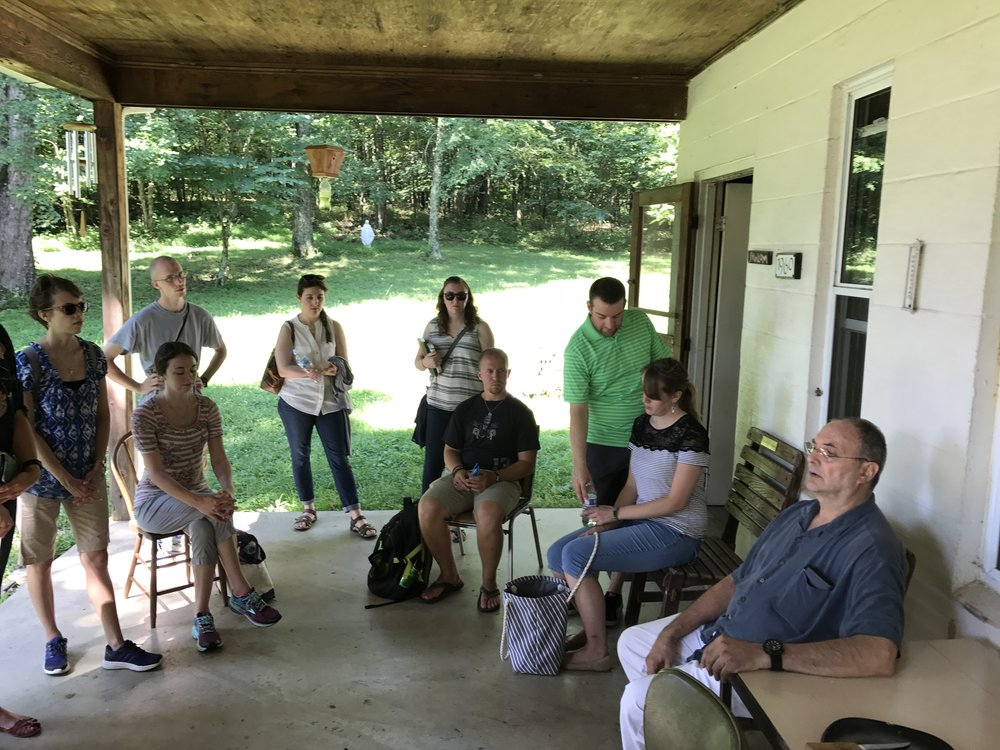 Brother Gregory holding court...and telling stories. On the porch of Thomas Merton's hermitage.