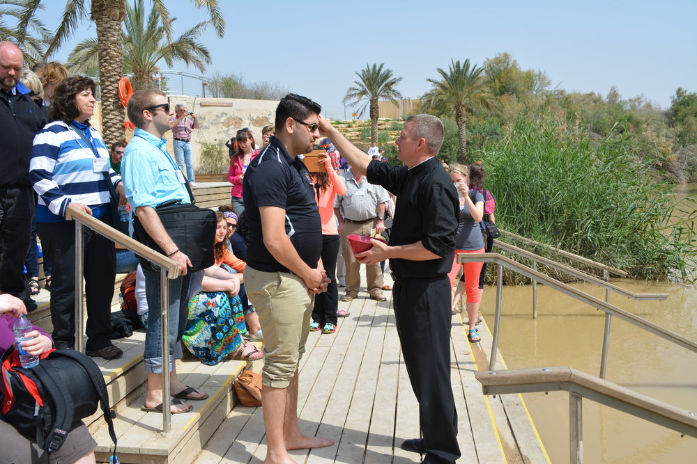 Shoaib renewing his Baptismal vows in the Jordan River.