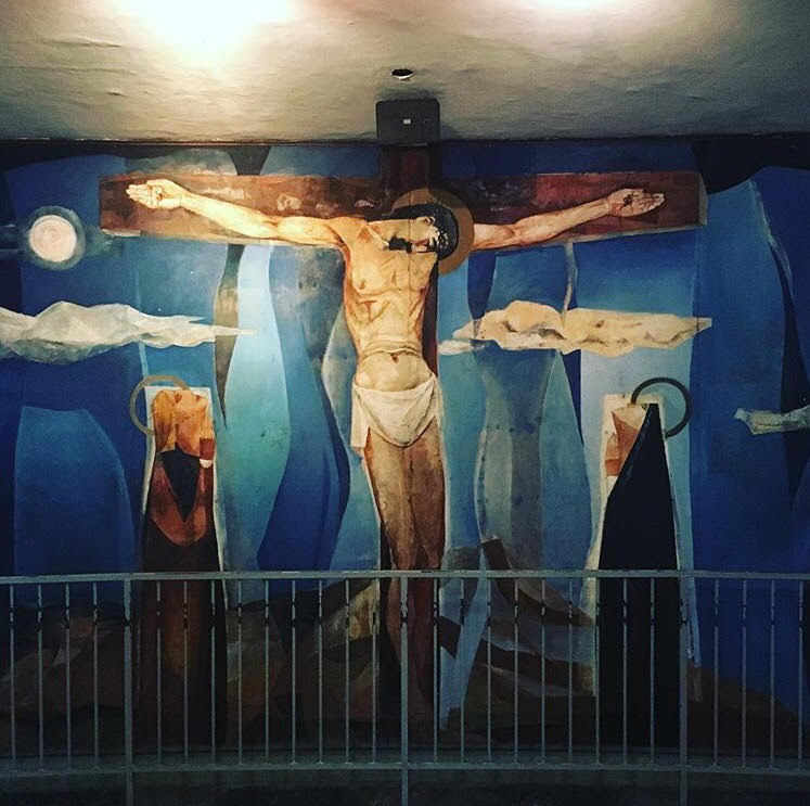 The Crucifixion serves as the ultimate symbol of Christ's oblation. This mural is among the Stations of the Cross painted by National Artist Vicente Manansala on the walls of the Church of Holy Sacrifice at the University of the Philippines Diliman. Photo by The Smart Gypsy