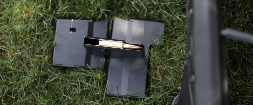 The SRS mags are single stack, made of steel, and not all that user friendly.  But they are tough.