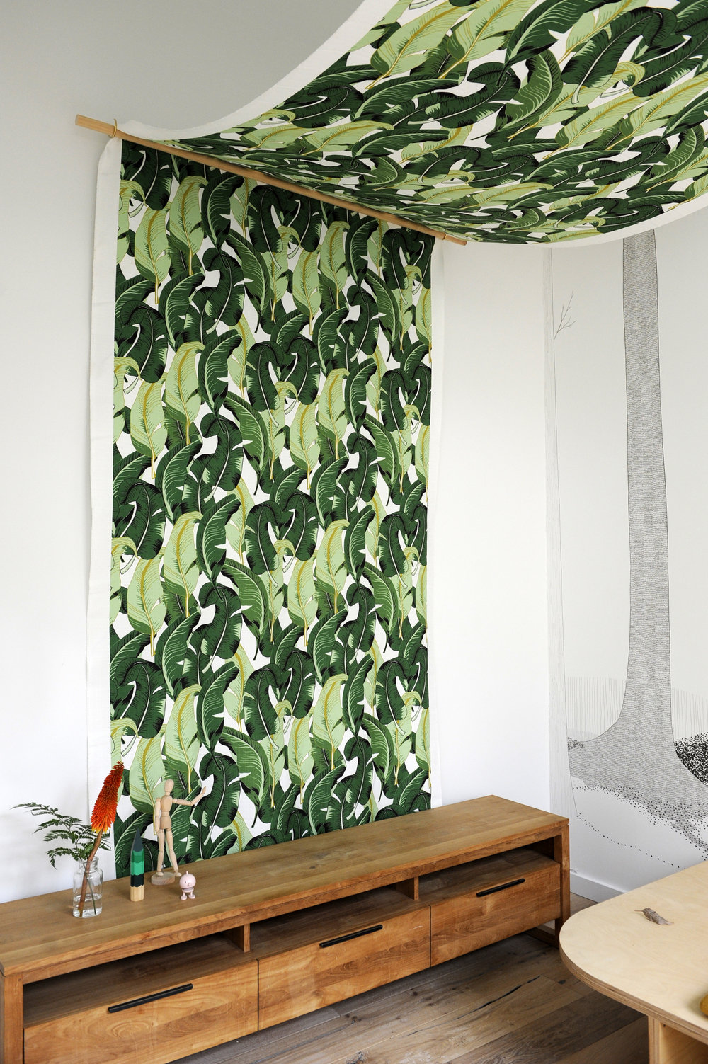 FEATURE CANOPY  + WALLPAPER | To enhance the 4m + ceilings, the simple black and white wallpaper and leafy canopy provided a green escape / contrast to the all too familiar life behind a TV screen | Image by Vanessa Hall
