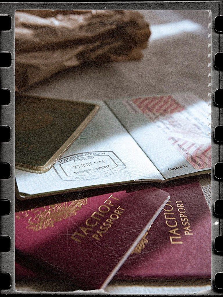 still life photography #AnotherLanguage #AnotherChildhood #Passports #Sickbag #Visa #Immigration #Stamps #Arrival #SophiaTerraZiva