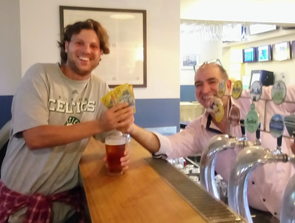 Bar Manager, Laurie, handing over the cash to a very happy Joe.
