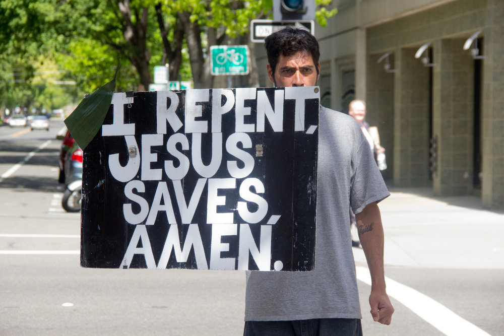 lightstock_man_sign_repent.jpg