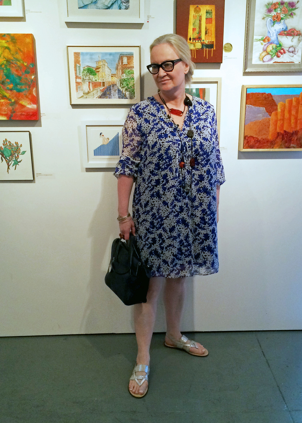 "At the reception of The National Association of Women Artists' Summer Small Works Exhibition, July 14, 2016: standing next to my watercolor painting, ""View of Palazza Soranzo van Axel, Venice""."