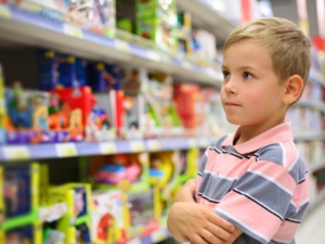 toy-store-boy-looking-at-shelves.jpg