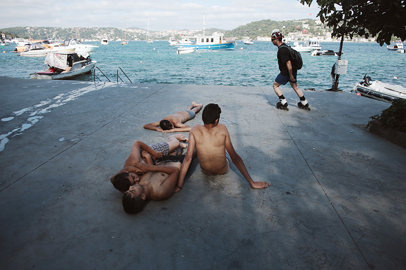 Young men basically cuddling after a forbidden, and dangerous, dip in the Bosphorus on a Sunday.