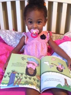 Baby Girl reading Daddys Girl.jpg