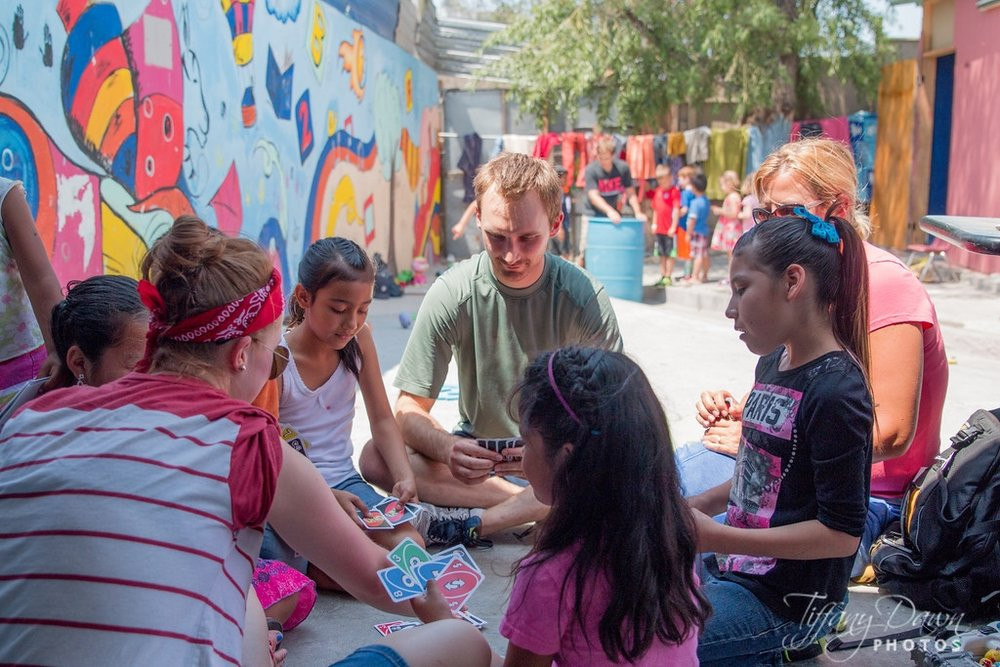 One of our Connect Group leaders plays cards and shares the love of Jesus with children during our trip to Tijuana, Mexico.