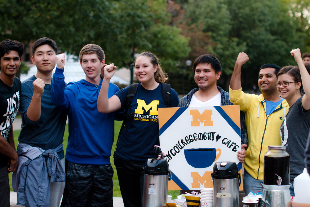 "Antioch Young Adults ""watering the grass"" at U of M by serving students through an Encouragement Cafe. (Photo Credit: Tiffany Hines)"