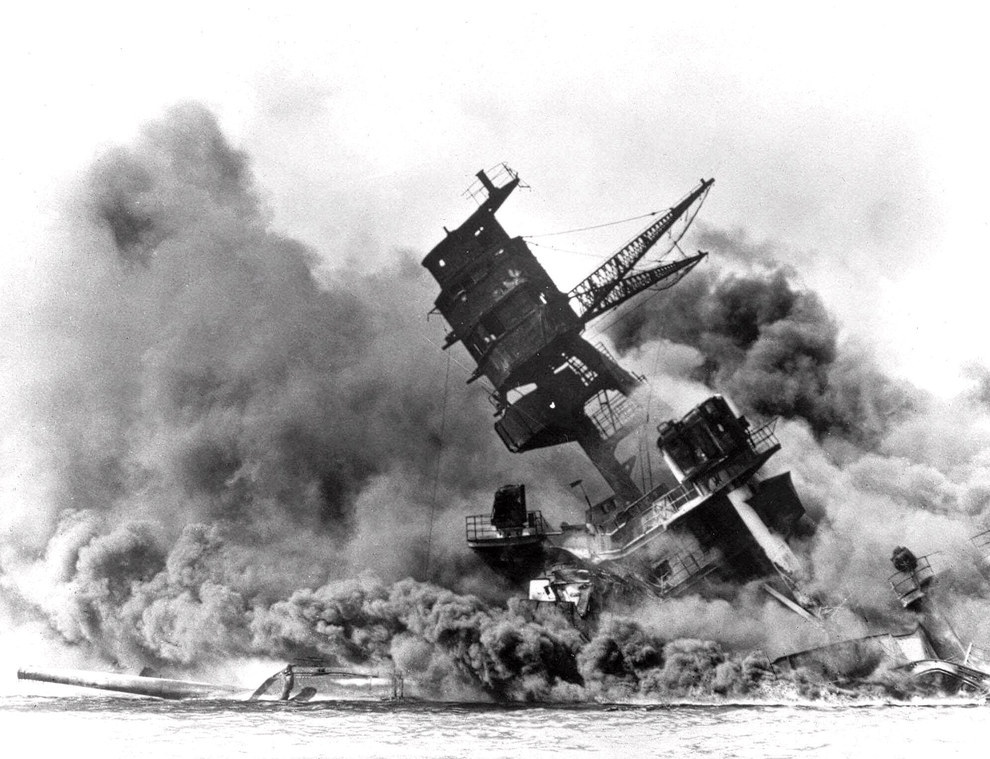 Smoke rises from the battleship USS Arizona as it sinks during the attack..jpg