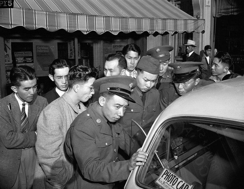 The next day, young Japanese-Americans, including several Army selectees, gather around a reporter's car in the Japanese section of San Francisco. .jpg