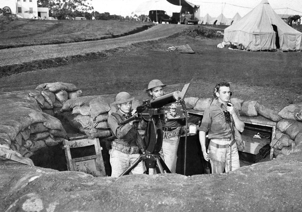 Troops man a machine gun nest at Wheeler Field against the incoming bombers..jpg