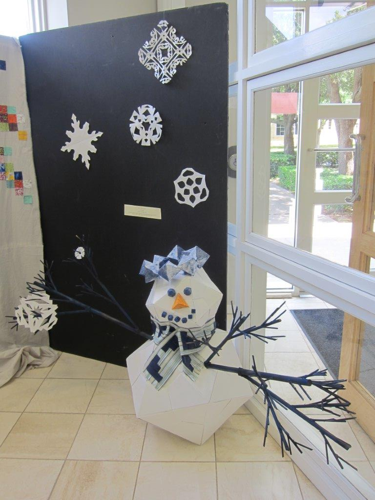 Platonic solid snowman with fractal arms and frieze patterned scarf and n-fold symmetry snowflakes