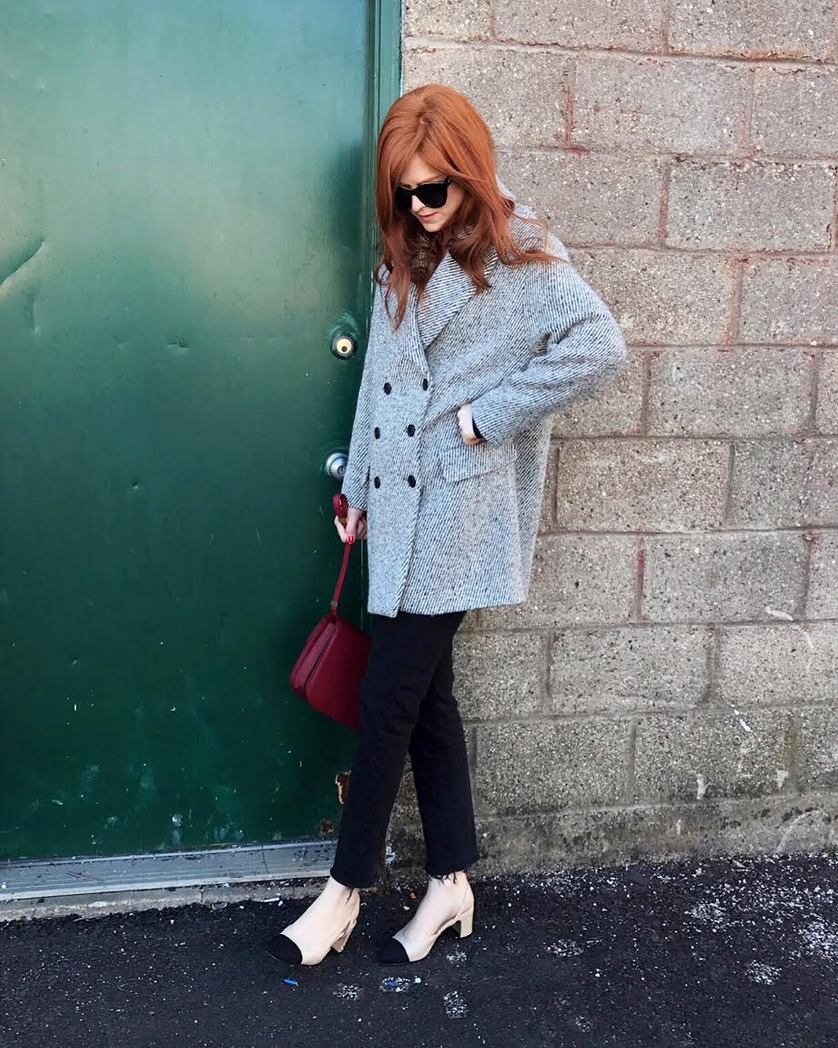 Zara oversized coat, Levi's black denim, Chanel slingbacks, Celine red box bag.