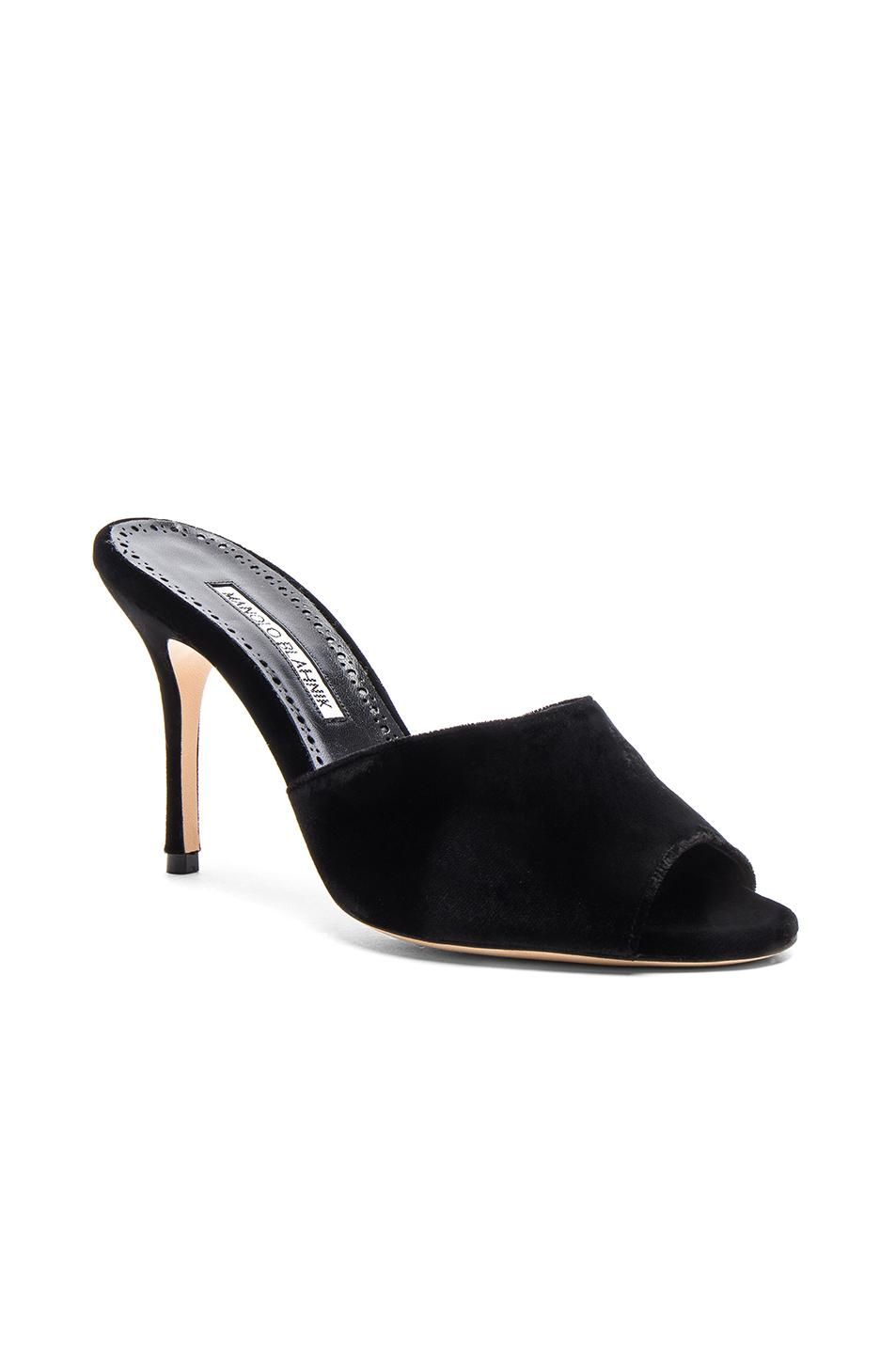 Manolo Blahnik - The perfect 90s velvet mule that can transform any denim, skirt or dress