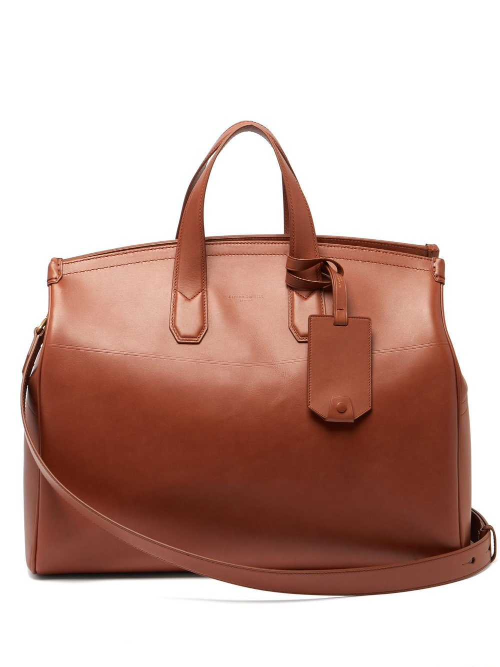 DUNHILL - every man needs a smart leather holdall. this one-bag-fits all by Dunhill works for travel, gym, or to and from the office.