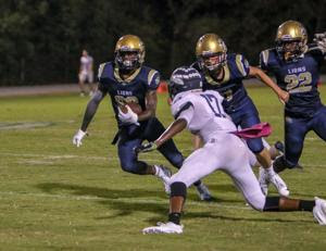 Dana Lucas Jr. snatched a fumble out of the air to give Loganville Christian its first touchdown of the game Friday night. However, the Lions couldn't find more offensive fire power and fell 50-23 to the Brookwood School.